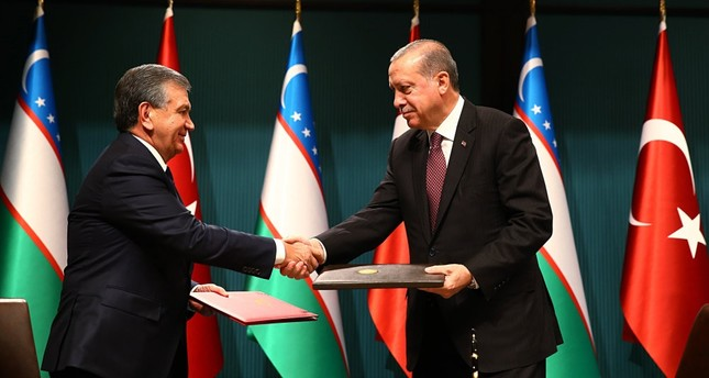 President Erdoğan and his Uzbek counterpart Shavkat Mirziyoyev shake hands during a meeting to boost bilateral trade and diplomatic relations, Ankara, Oct. 25.