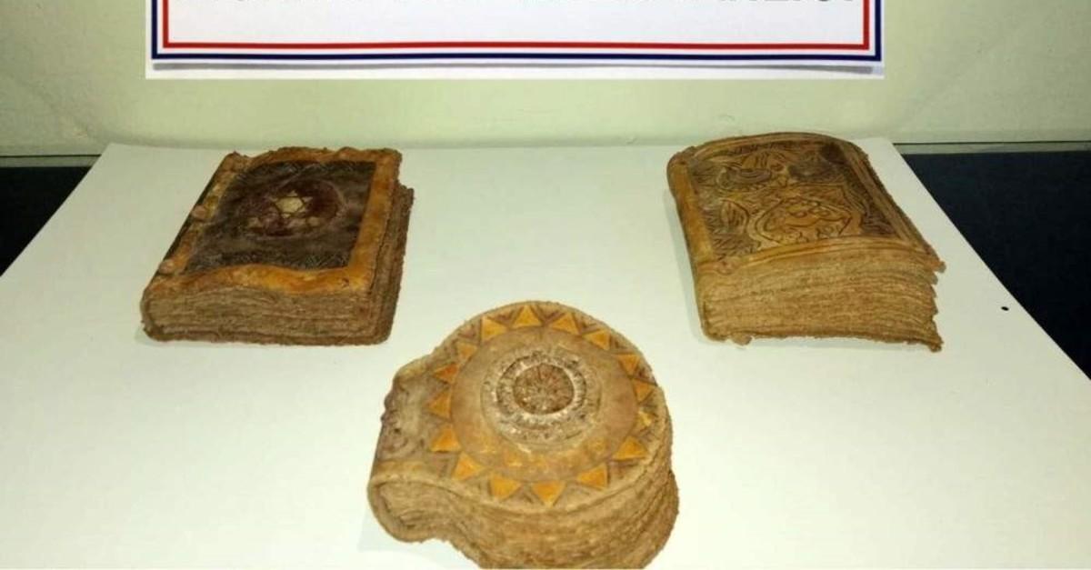 Seized Torahs on display at a gendarme base. (DHA Photo)