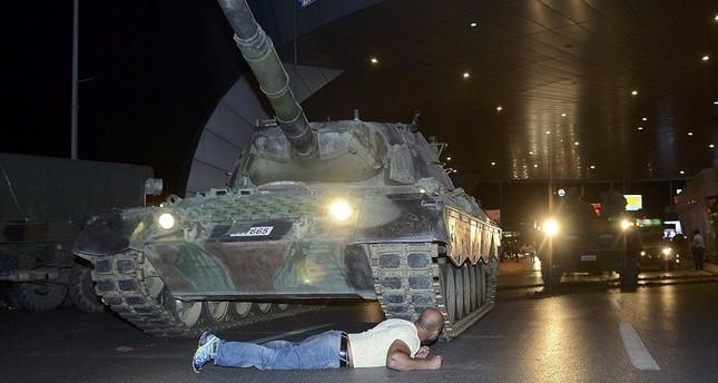 Metin Doğan lies before a tank on July 15, 2016.