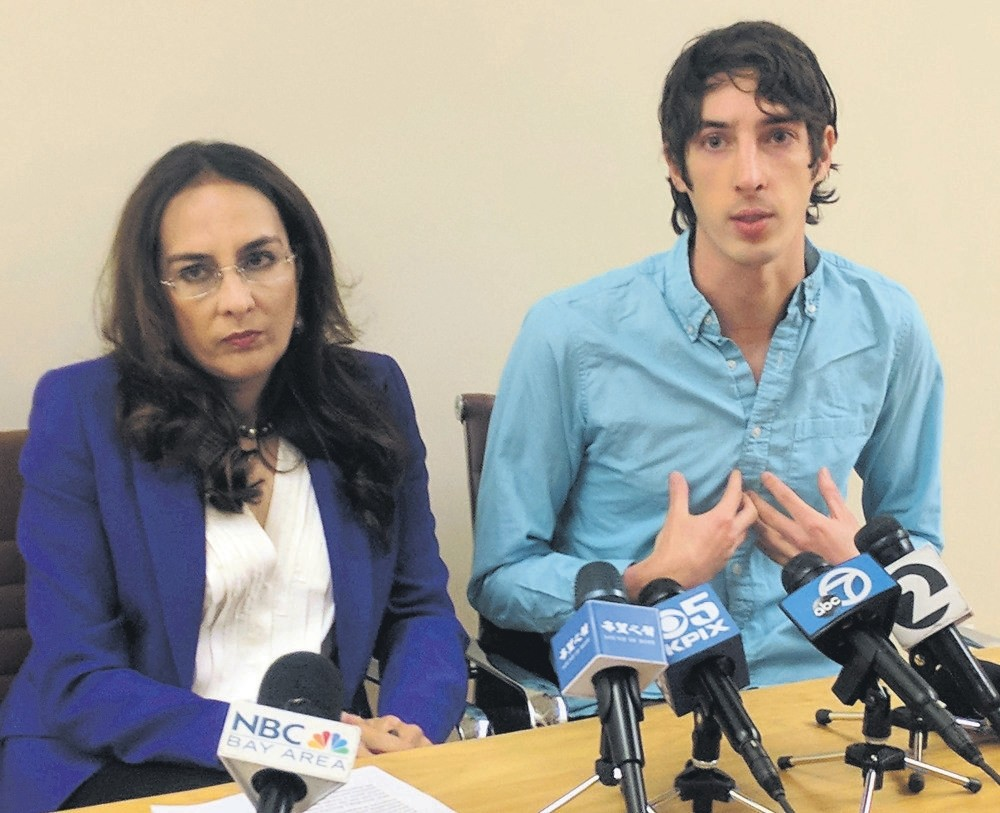 James Damore (R), a former Google engineer fired in 2017 after writing a memo about the biological differences between men and women, speaks at a news conference next to his attorney in San Francisco.