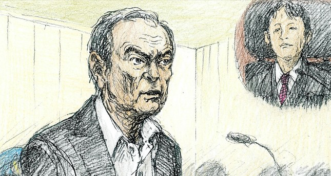 This courtroom sketch depicts former Nissan chairman Carlos Ghosn in a courtroom at the Tokyo District Court in Tokyo, yesterday.