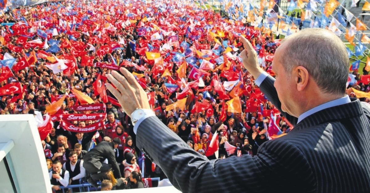 President and Justice and Development Party (AK Party) Chairman Recep Tayyip Erdou011fan greets the crowd at a rally in Sakarya, July 23, 2019.