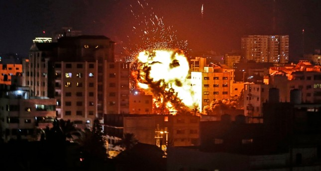 An explosion is seen among buildings during an Israeli airstike on occupied Gaza City, May 4, 2019.