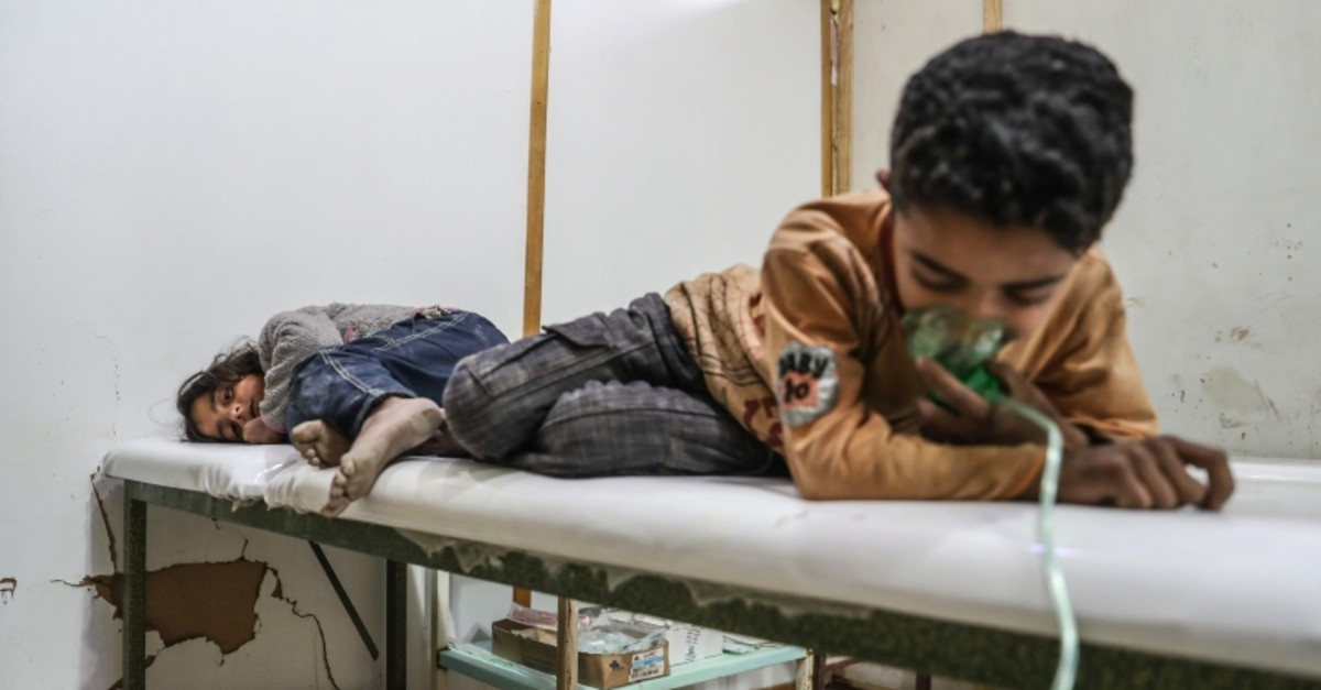 Affected children receive treatment after a gas attack on al-Shifunieh village, in Eastern Ghouta, Syria, February 25, 2018. (EPA Photo)