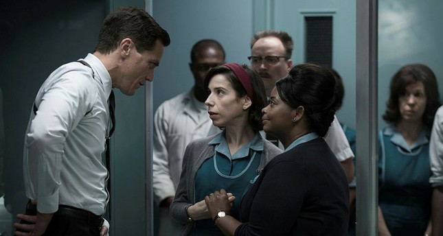 This image released by Fox Searchlight Pictures shows Michael Shannon, from left, Sally Hawkins and Octavia Spencer in a scene from the film, The Shape of Water.  (Fox Searchlight Pictures via AP)