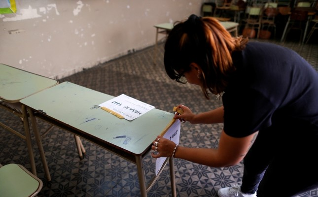 An election assistant prepares a classroom in a school, which will serve as a polling station one day ahead of presidential elections in Buenos Aires, Argentina, Oct. 26, 2019. (Reuters Photo)