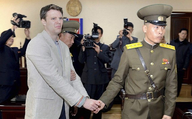 A file handout photo provided by the official Korean Central News Agency shows Otto Frederick Warmbier (L) in relation to his trial in Pyongyang, North Korea, 16 March 2016. (EPA Photo)
