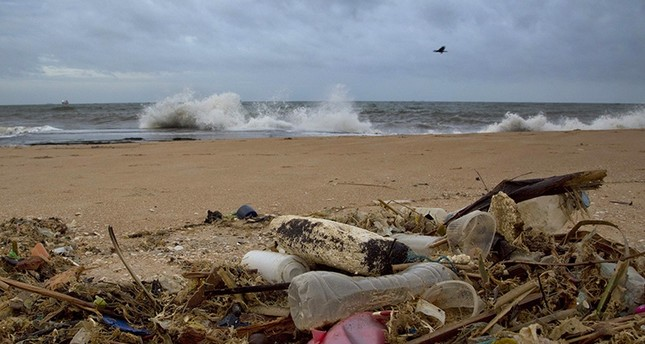 In this Aug. 13, 2015, file photo, a plastic bottle lies among other debris washed ashore on the Indian Ocean beach in Uswetakeiyawa, north of Colombo, Sri Lanka. (AP Photo)