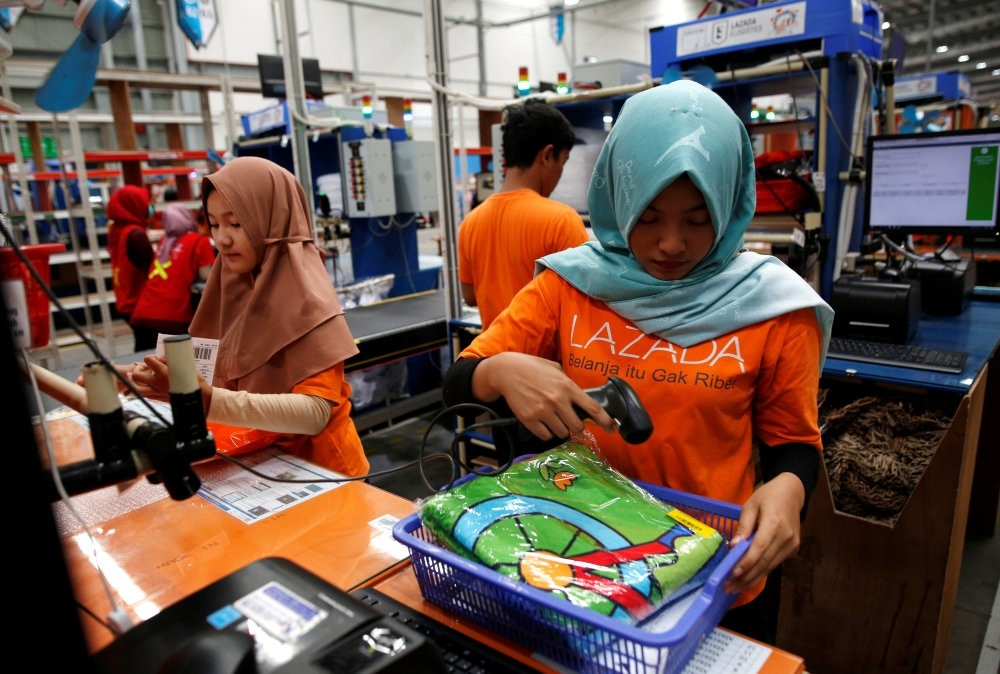 Workers package items for delivery at online retailer Lazada's warehouse in Depok, south of Jakarta, March 26.