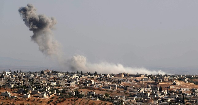 Smoke billows following deadly regime airstrikes on the village of Kafr Sajna on the southern outskirts of Syria's Idlib province, August 16, 2019.