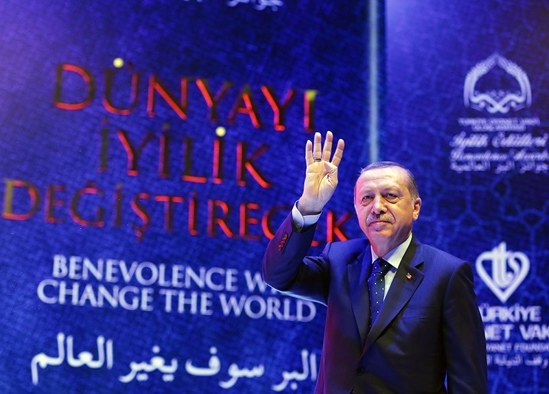 A handout photo made available by the Turkish President Press office shows, Turkish President Recep Tayyip Erdou011fan waving to his supporters during the International Benevolence Awards ceremony in Istanbul, Turkey, March 12, 2017.