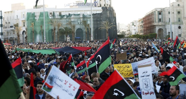 Protesters march during a demonstration to stand against Gen. Khalifa Haftar's armed offensive in Tripoli, at Martyrs Square in central Tripoli, Libya, April 12, 2019.