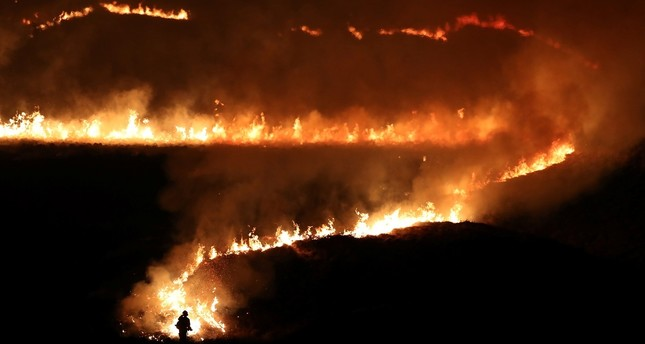 A fire is seen burning on Saddleworth Moor near the town of Diggle, Britain, February 27, 2019. REUTERS Photo