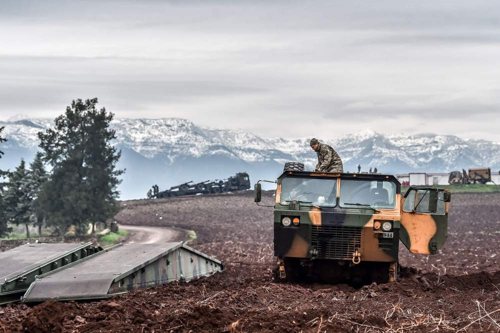 Turkish troops wait near the Syrian border at Hassa, Hatay, as part of Operation Olive Branch against YPG terrorists in northern Syria, Jan. 24.