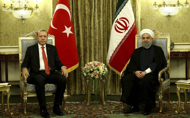 President Erdoğan (L) meets with Iranian President Rouhani at the Saadabad Palace in Tehran, Iran, Oct. 4.