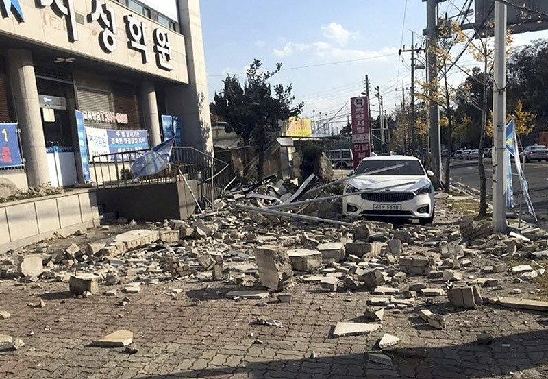 Debris from a collapsed wall is scattered in front of a shop after an earthquake in Pohang, South Korea, Wednesday, Nov. 15, 2017. (AP Photo)