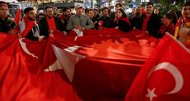 People of the Turkish community living in Germany celebrate on Kurfuerstendamm boulevard after news bulletin on the outcome of Turkey's referendum on the constitution, in Berlin, Germany, April 16, 2017. (Reuters Photo)