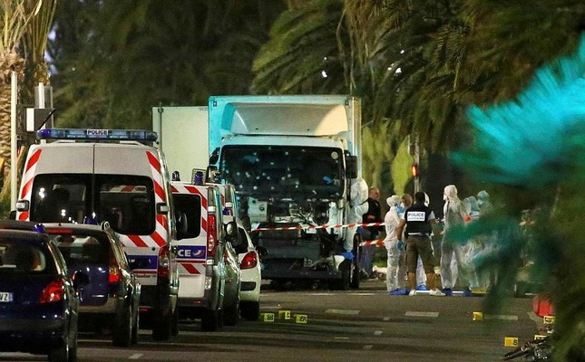 French police forces and forensic officers stand next to a truck July 15, 2016 that ran into a crowd celebrating the Bastille Day national holiday on the Promenade des Anglais killing at least 60 people in Nice, France, July 14. (Reuters Photo)