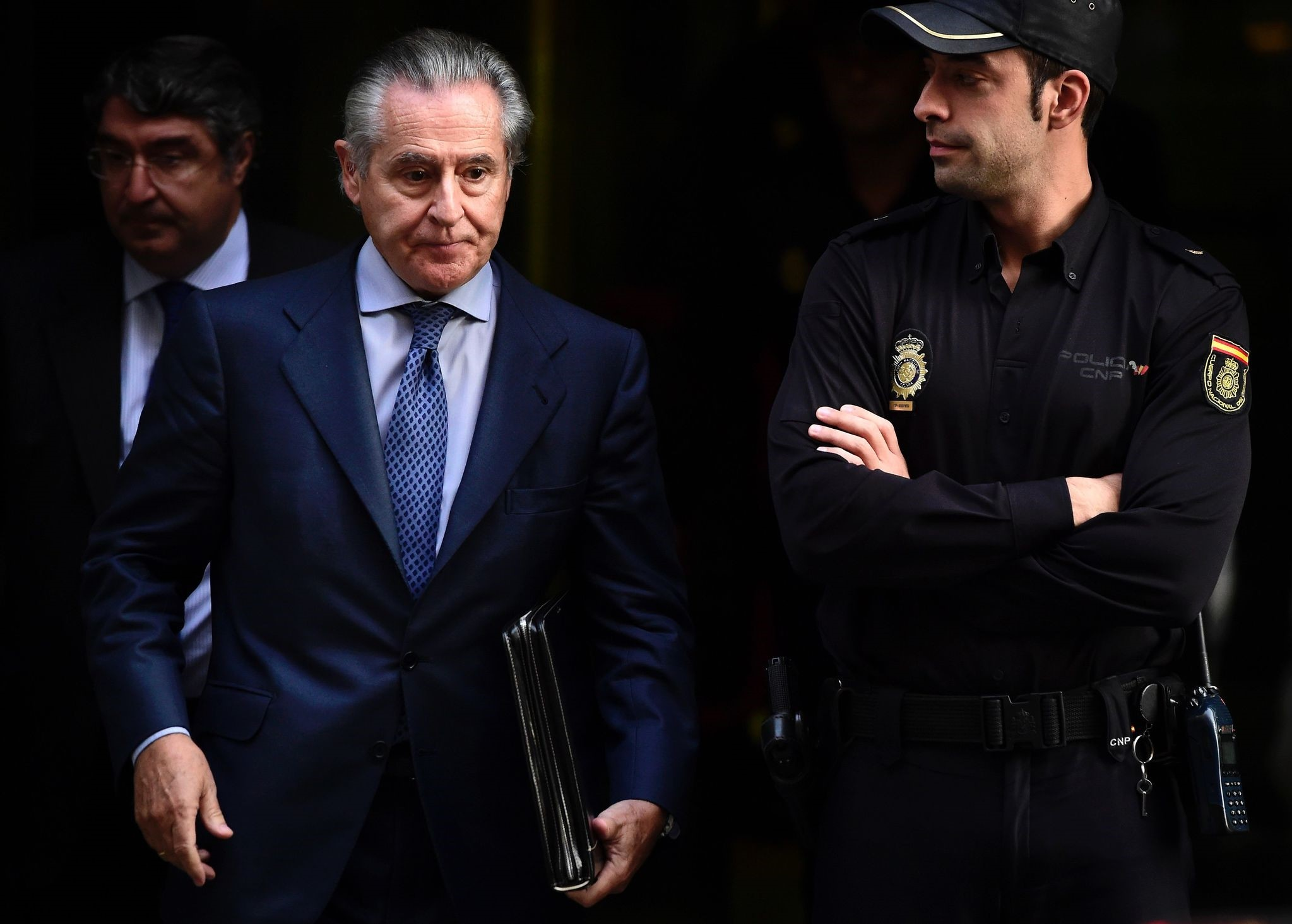 This file photo taken on October 16, 2014 shows Caja Madrid's former head Miguel Blesa leaving a hearing in Madrid accused of spending sprees with a company credit card. (AFP Photo)