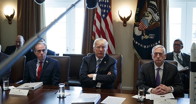 Secretary of Veterans Affairs David Shulkin, left, and Secretary of Defense Jim Mattis, right, listen as President Donald Trump speaks during a cabinet meeting at the White House, Thursday, March 8, 2018, in Washington. (AP Photo)