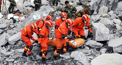 pRescuers retrieved 10 bodies on Sunday as the increasingly desperate search continued for at least 93 people missing a day after a massive landslide buried a mountain village in south-western...