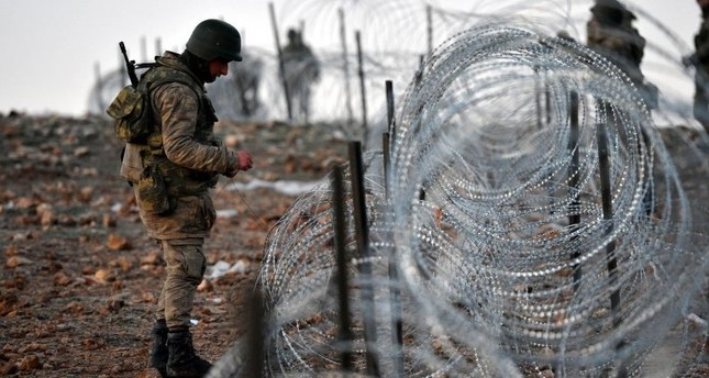 A Turkish soldier standing near wire fence as Operation Euphrates Shield, a counter-terror offensive starting on August 2016 by Turkish-backed Free Syrian Army to clear the Syrian towns from Daesh and PKK-affiliated terrorist groups, is continuing.