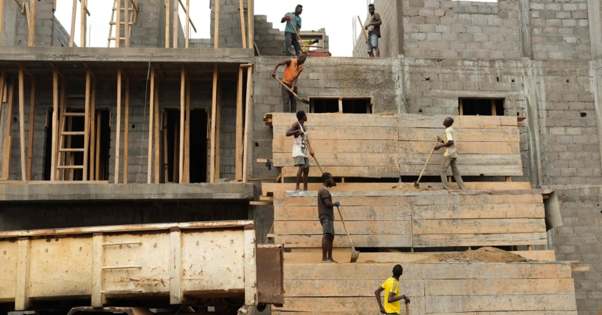 Laborers work on a building construction site, in Bangui, capital of the Central African Republic, July 11, 2019.