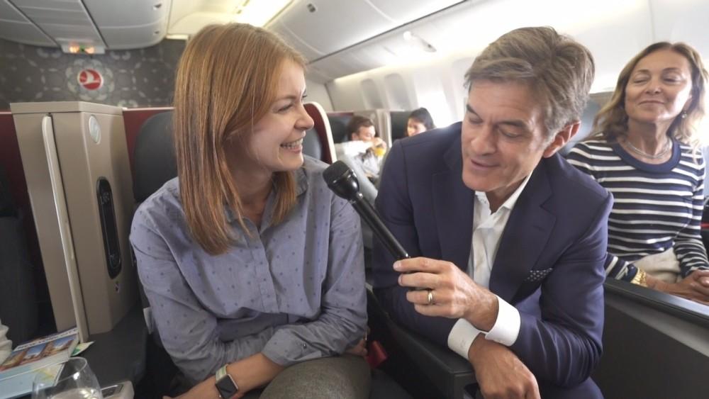 Mehmet Oz interviews a passenger aboard a THY flight.