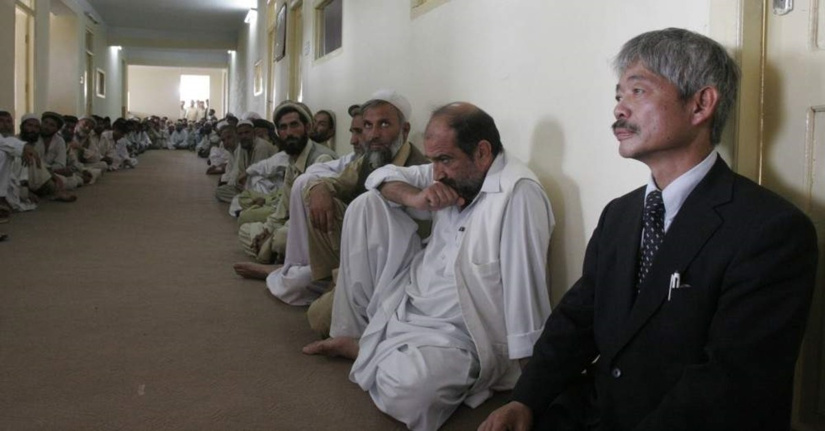 In this Aug. 28, 2008, file photo, Tetsu Nakamura, right, executive director of PMS Japan, participates in the memorial service for Japanese aid worker Kazuya Ito at the governor's house in Jalalabad, Nangarhar province, Afghanistan. (AP Photo)