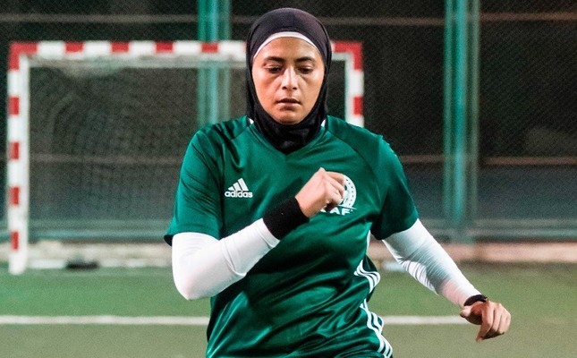 Egyptian referee Hanan Hassan warms up prior to a women's football match in Cairo, June 3.