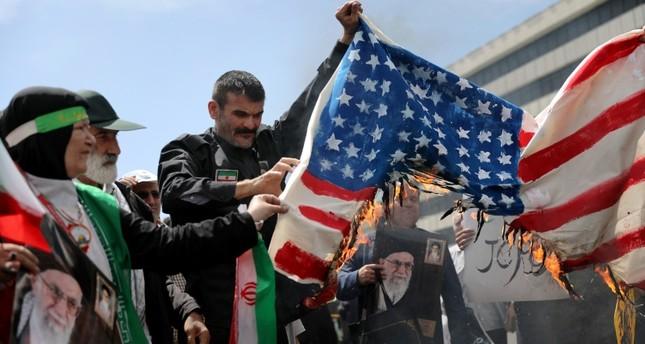 Iranian worshippers burn a representation of a U.S. flag during a rally after Friday prayer in Tehran, Iran, Friday, May 10, 2019. (AP Photo)