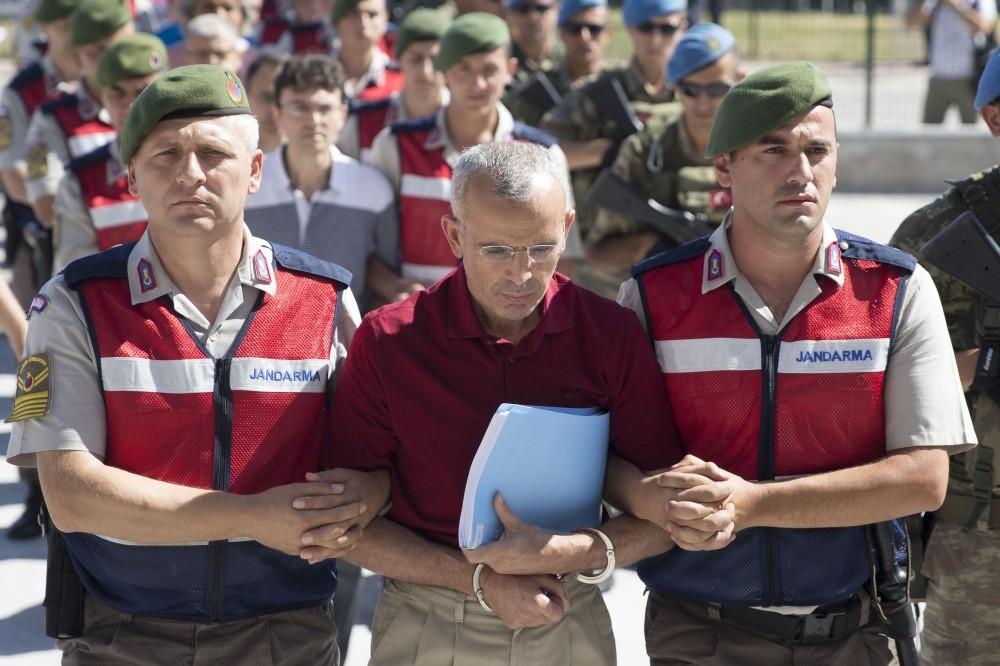 Gendarmerie officers escort Mehmet Diu015fli to court.