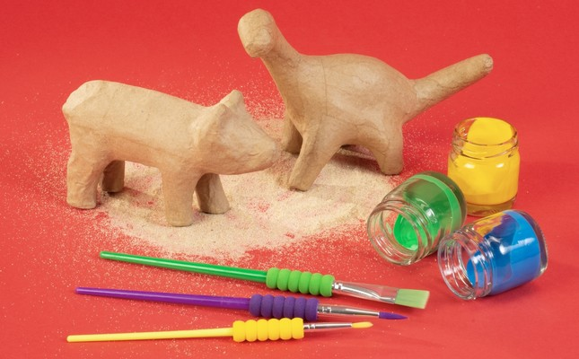 """At the """"Dig, Discover, Paint!"""" workshop, children form animal or plant figures with clay and then color them."""