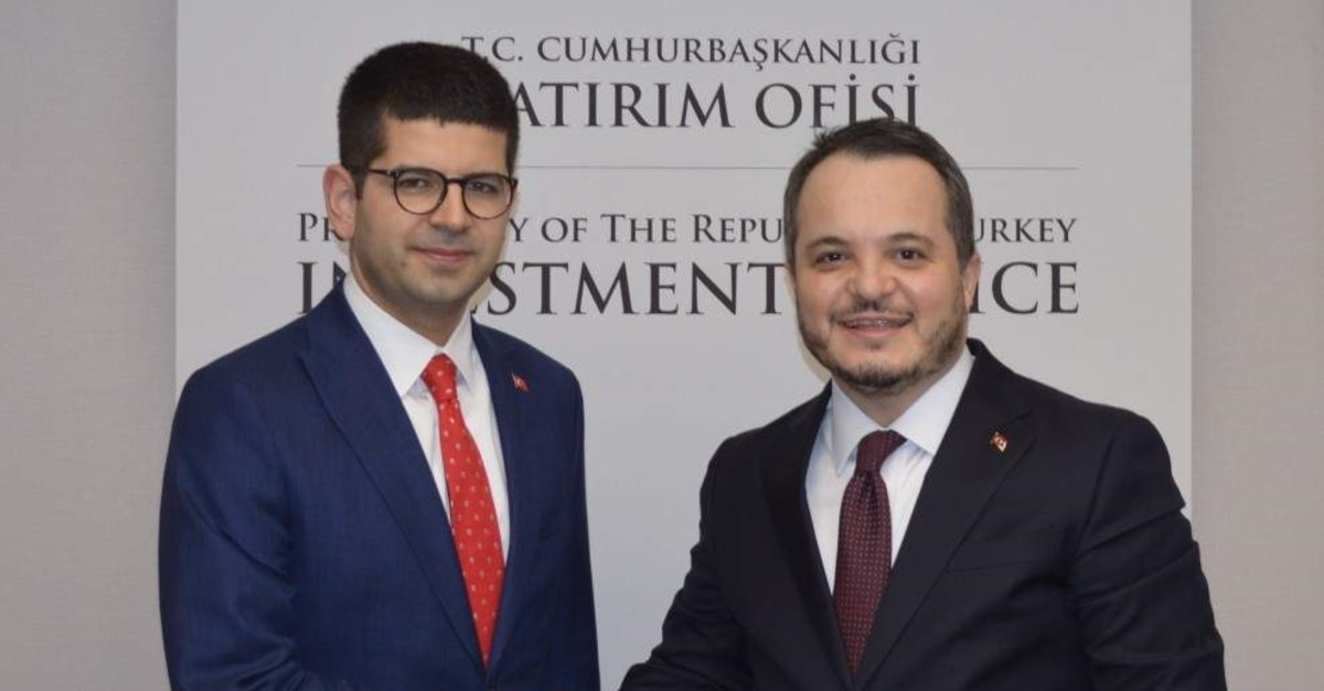 Former head of the  presidential investment office Arda Ermut (right) and new chair (left). (DHA Photo)
