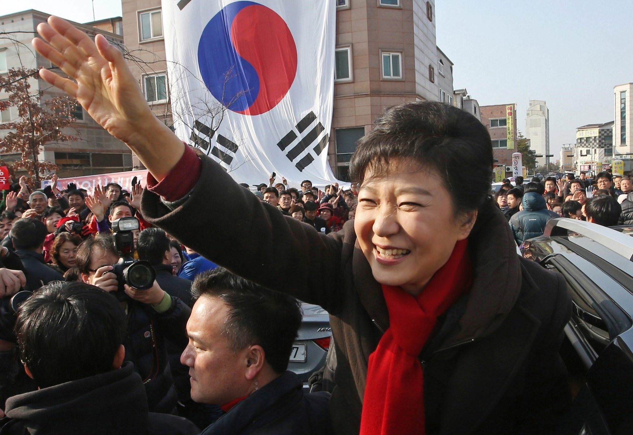 Ex-South Korean president Park Geun-hye waves to supporters during her election campaign rally in Hwaseong, south of Seoul, South Korea, Dec. 17, 2012. (AP Photo)