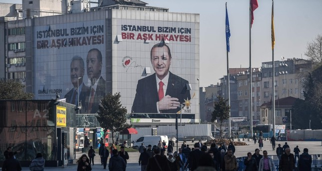 An election poster covers the facade of a building with a picture of President Recep Tayyip Erdoğan, Istanbul, March 26, 2019.