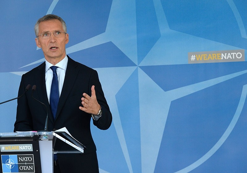 NATO Secretary General Jens Stoltenberg gestures as he talks to the media at the NATO headquarters in Brussels, on July 13, 2017. (AFP Photo)