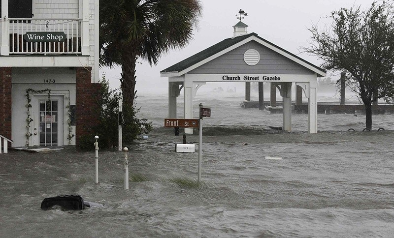 High winds and water surround buildings as Hurricane Florence hits Front Street in downtown Swansboro N.C., Friday, Sept. 14, 2018. (AP Photo)