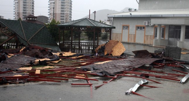 After severe winds and heavy rain, the roof of a 10-story building flew off and landed on school grounds in the Gaziosmanpaşa district of Antalya last week. (DHA Photo)