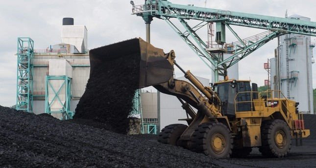 In this file photo taken on April 19, 2017 a front-end loader dumps coal at the East Kentucky Power Cooperative's John Sherman Cooper power station near Somerset, Kentucky. (AFP Photo)