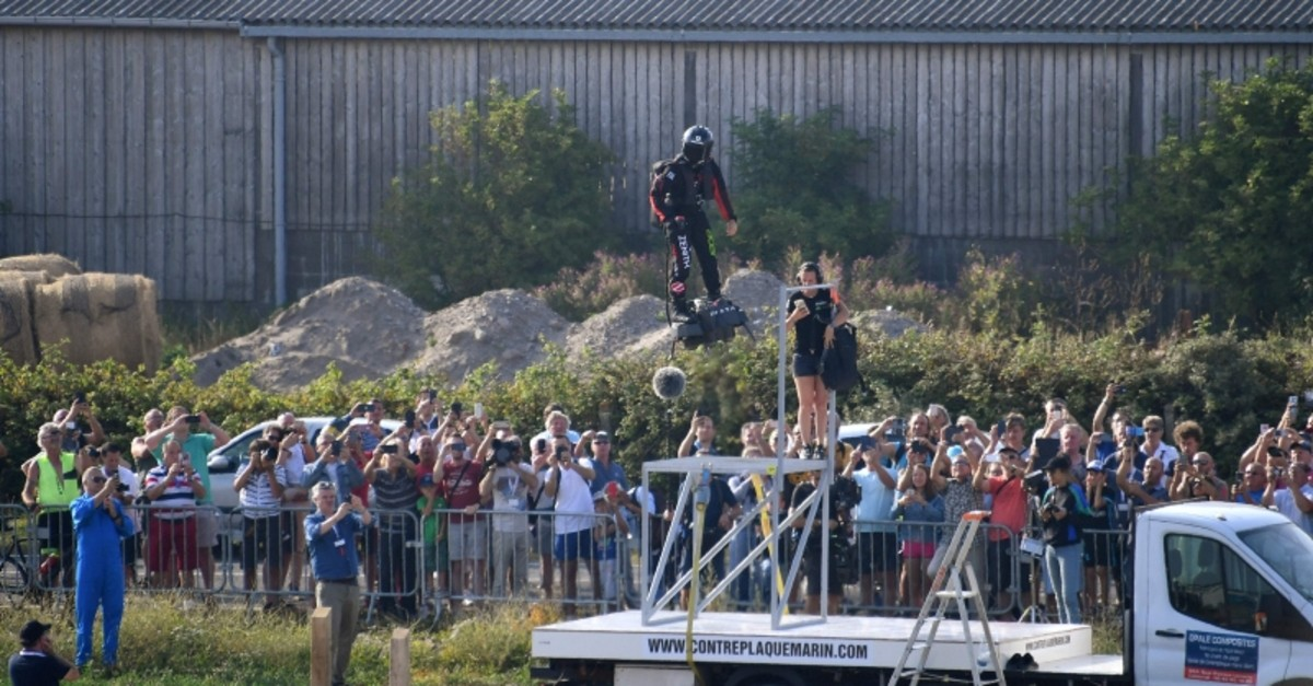 Franky Zapata (C) stands on his jet-powered ,flyboard, as he takes off from Sangatte, northern France, attempting to fly across the 35-kilometre (22-mile) Channel crossing in 20 minutes (AFP Photo)