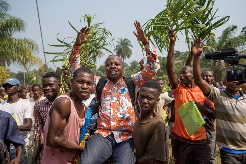 Residents celebrate the return of Lucien Ambunga (C), the priest of the village, after he recovered from Ebola and returned to the village of Itipo, in the Iboko health zone, DRC,  June 8, 2018. (REUTERS Photo)