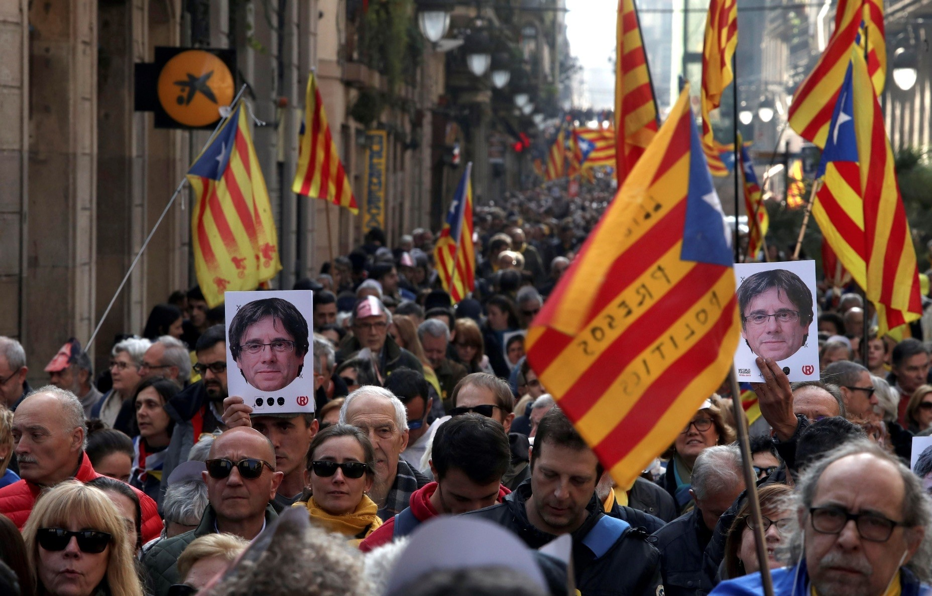 People attend a demonstration in support of former Catalonian President Carles Puigdemont outside the Catalan Parliament, Barcelona, Jan. 30.