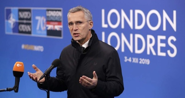 NATO Secretary General Jens Stoltenberg gives a statement prior to the arrival of NATO leaders, meeting at The Grove hotel and resort in Watford, Hertfordshire, England, Wednesday, Dec. 4, 2019. (AP Photo)