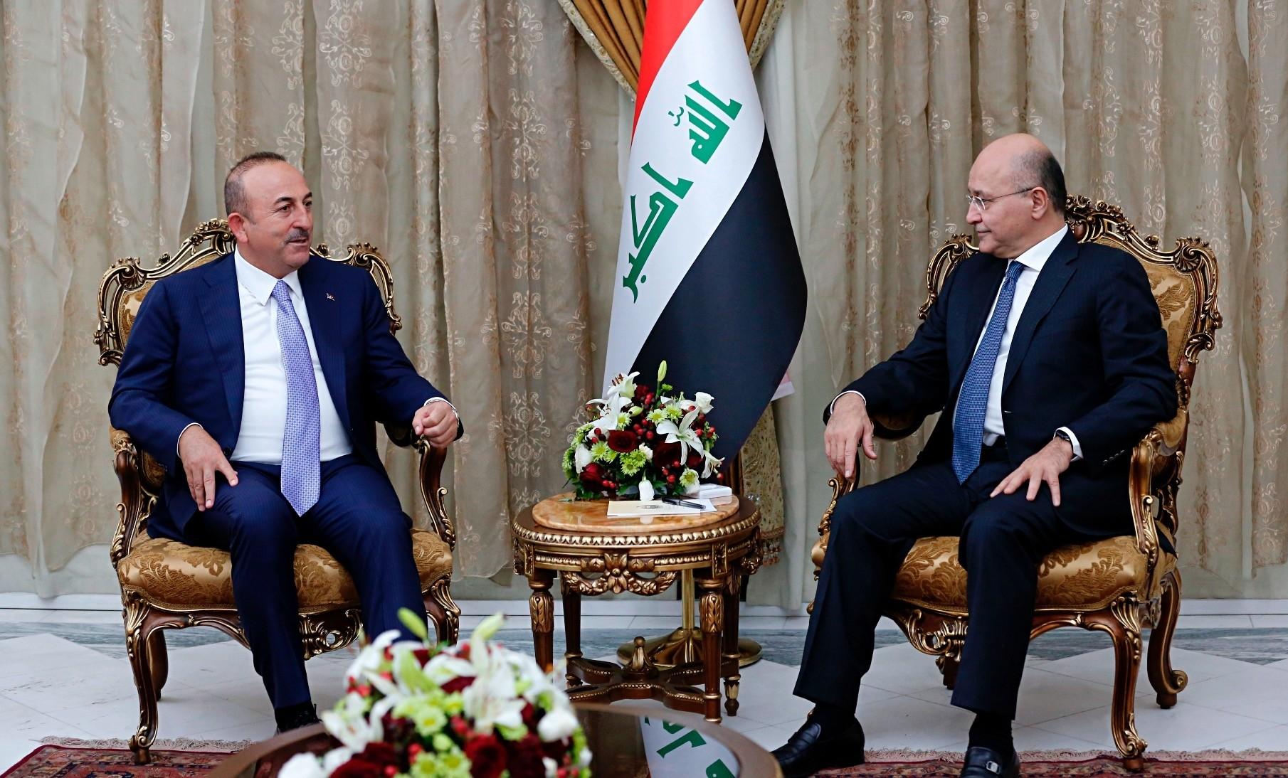 Turkish Foreign Minister Mevlu00fct u00c7avuu015fou011flu (L) meets with Iraqi President Barham Salih in Baghdad, yesterday.