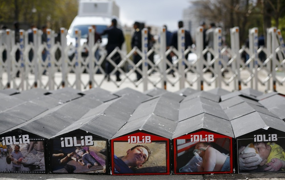 Mock-up coffin displayed during a protest on Friday in front of Iranian Embassy in Ankara against Assad regime's chemical attacks on Idlib (AA Photo)