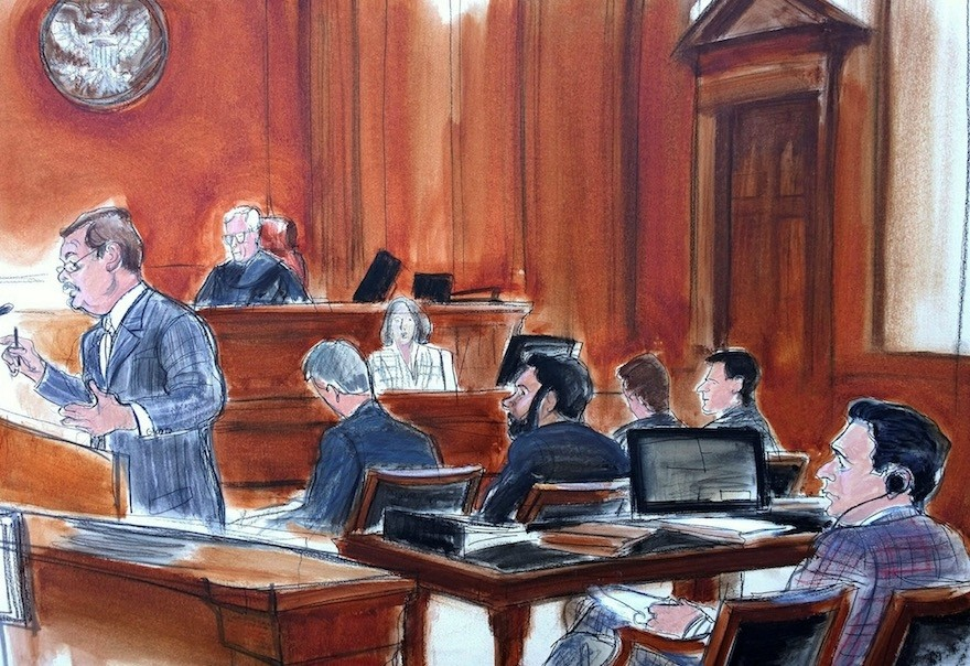 In this Nov. 28, 2017 courtroom sketch, defense attorney Victor Rocco, left, gives his opening statement to the jury, as his client, Mehmet Hakan Atilla, right rear, listens from the defense table in New York. (Elizabeth Williams via AP)