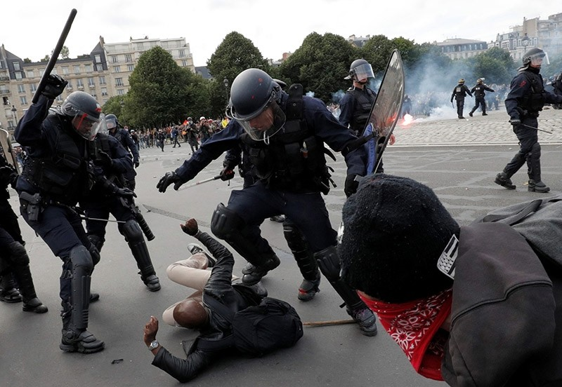 French riot police and gerndarmerie units beat a protestor. (Reuters File Photo)