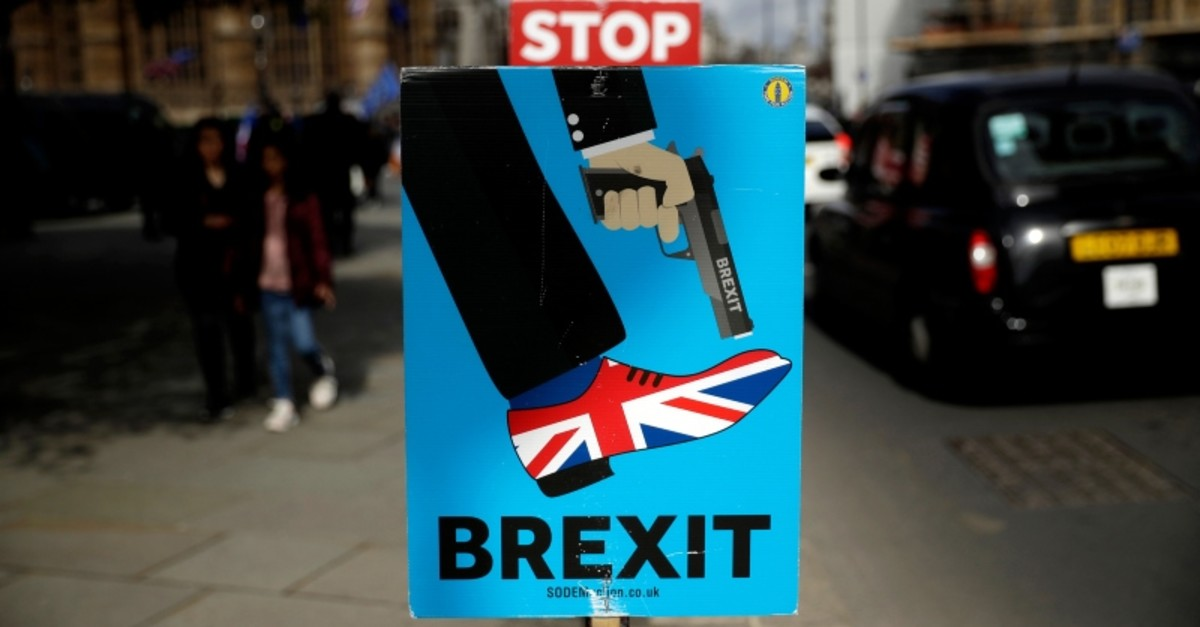 Placards placed by anti-Brexit supporters stand opposite the Houses of Parliament in London, Monday, March 18, 2019. (AP Photo)
