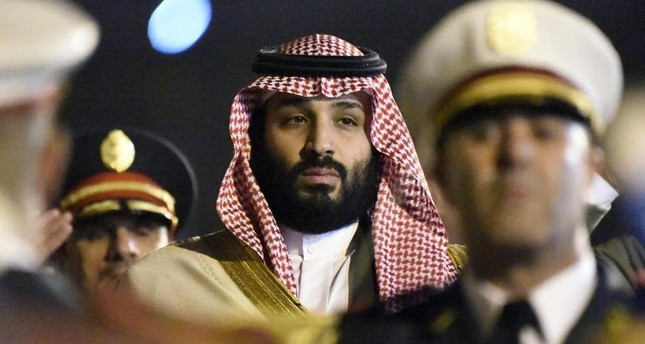 Saudi Crown Prince Mohammed bin Salman is seen behind a military band upon his arrival at Algiers International Airport on Dec. 2, 2018. AFP Photo